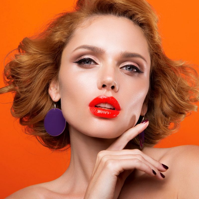 Beautiful young model with red lips and retro hairstyle